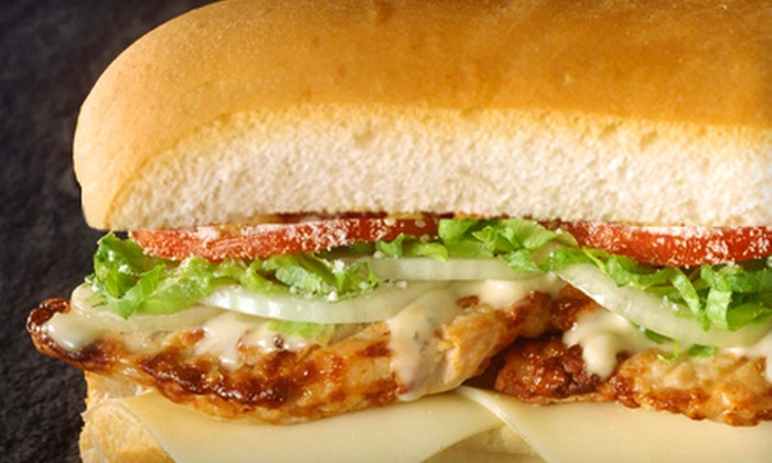 Tracey's Original Irish Channel Bar - New Orleans: $12 for $25 Worth of Po Boys, Local Pub Grub, and Beverages at Tracey's Original Irish Channel Bar