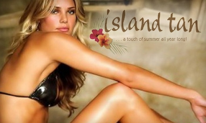 Island Tan Salon & Spa - Multiple Locations: $25 for $50 Worth of Tanning and Eyelash Extensions at Island Tan Salon & Spa