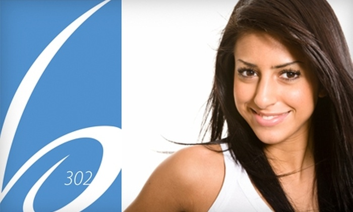 Blue 302 - Central Business District: $20 for a Haircut and Style (Up to $45 Value) or $42 for an Ultrasonic Facial (Up to $100 Value) at Blue 302