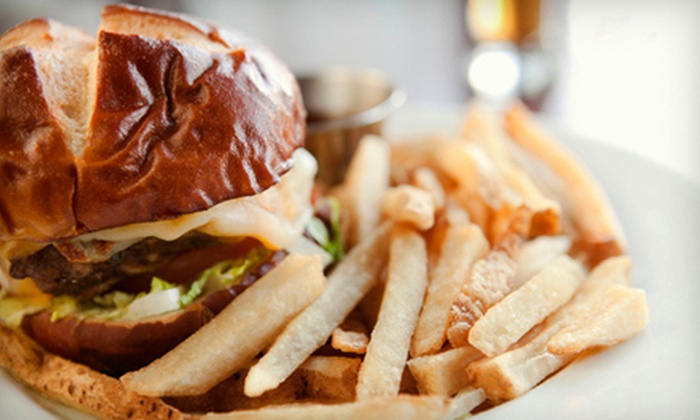 Sports Page Bar - Sunrise Rim: $15 for a Burger Meal with Drinks for Two at Sports Page Bar (Up to $30 Total Value)