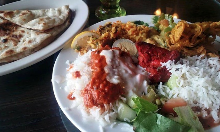 Dhaniya Drums Indian Food - Tampa: $18 for Indian Dinner and Drinks for Two at Dhaniya Drums Indian Food ($30 value)