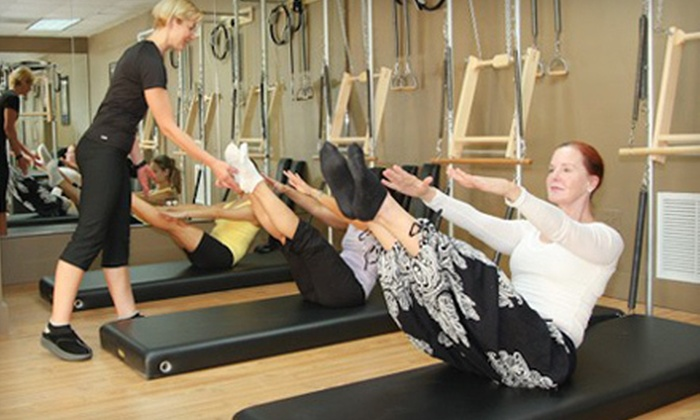 OptimalFit Pilates Studio - Miami International Business Park: $10 Toward Yoga and Pilates Classes or Massage