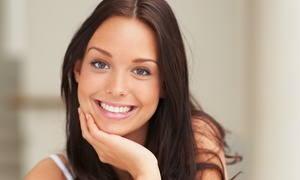 Planet Beach: One or Three Light-Generated Teeth-Whitening Sessions at Planet Beach (Up to 54% Off)