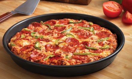 Large Two-Topping Pizza with Soda and Sides from Domino's Pizza (Up to 55% Off). Three Options Available.