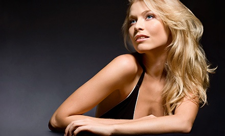 Haircut Package with Deep-Conditioning Treatment and Optional Partial Highlights at Salon In The City (Up to 59% Off)