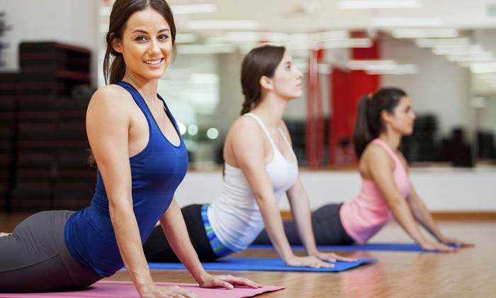 Yoga & Fitness Passport - Lincoln: $20 for 30-Class Yoga and Fitness Pass from Yoga & Fitness Passport  ($300 Value)
