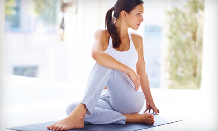 In Motion Yoga - Multiple Locations: $30 for 30 Yoga and Fitness Classes at In Motion Yoga ($315 Value)