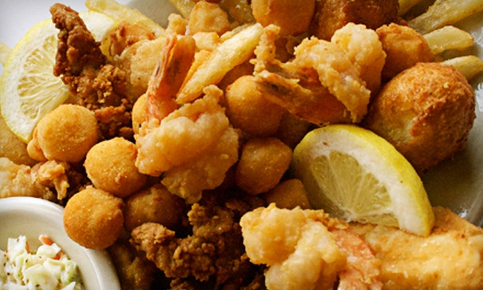Lighthouse Restaurant - Fanning Springs: Seafood or Steak Meal with Appetizers for Two or Four at Lighthouse Restaurant (Up to 61% Off)