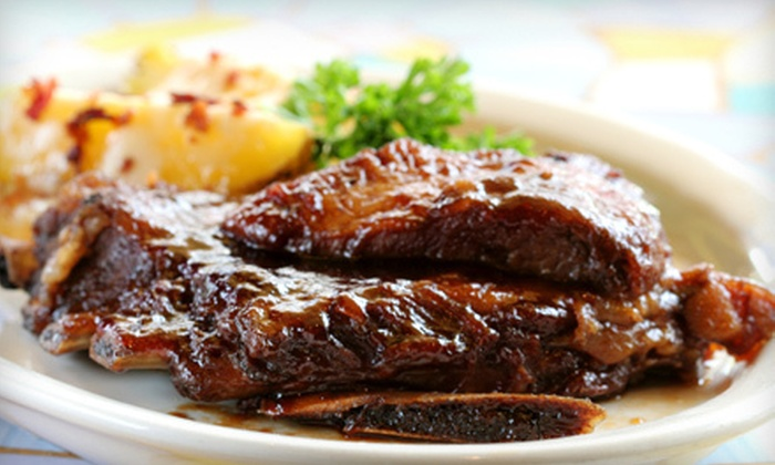 Ron's Pit Stop BBQ - Alamo Square: Two Slabs of Ribs and Two Sides, or $15 for $40 Worth of Barbecue Food and Drinks with Delivery at Ron's Pit Stop BBQ