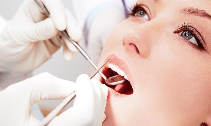 Landmark Dental - Norwood: $49 for Dental Cleaning with Exam, X-rays, and Take-Home Whitening Kit at Landmark Dental ($488 Value)
