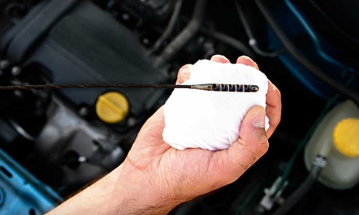 Express Oil Change & Service Center - Multiple Locations: $25 for Oil Change and Tire Rotation at Express Oil Change & Service Center ($62.98 Value). Two Locations Available.