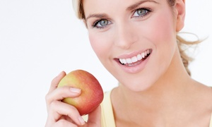 Advanced Center For Cosmetic and Implant Dentistry: $26 for Six Month Smiles or Invisalign at Advanced Center for Cosmetic & Implant Dentistry ($900 Value)