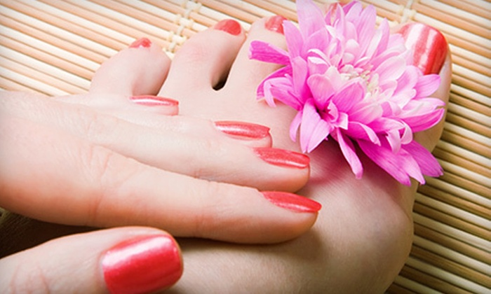 Nail Garden - Oldtown: Shellac Manicure with Eyebrow Wax, or Deluxe Pedicure at Nail Garden (Up to Half Off)