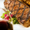 Half Off Steak-House Cuisine at Wrought Iron Grill