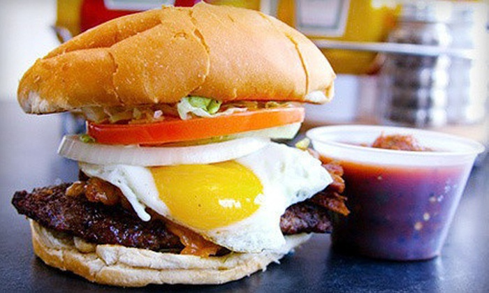 Cuatro's - West University: $10 for $20 Worth of Tacos and Burgers at Cuatro's