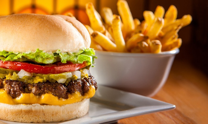 Fatburger - Multiple Locations: C$16 for Fatburgers with Cheddar Cheese and Skin-On Fries for Two at Fatburger (C$25.34 Value)