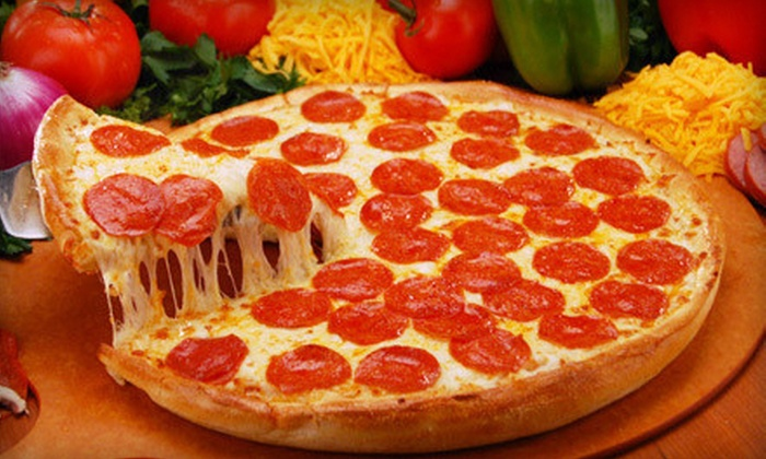 Simple Simon's Pizza - Multiple Locations: Pizza, Calizone, and Breadsticks, or Two Pizzas with Wings at Simple Simon's Pizza (Half Off). Five Locations Available.
