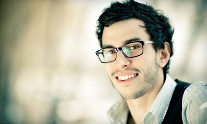 International Optique - Hampden: $50 for $125 Toward Frame with Prescription Lenses at International Optique