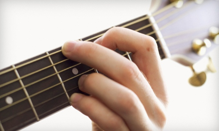 Give To Live Guitar Studios - Multiple Locations: $40 for One Month of Private Guitar Lessons at Give To Live Guitar Studios ($100 Value)
