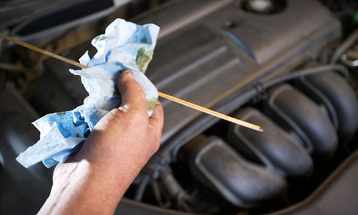 C & C Automotive - South City: $29 for an Oil Change, Vehicle Inspection, and Tire Rotation at C & C Automotive (Up to $126.58 Value)