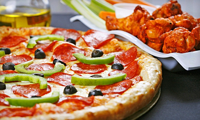 The Pizza Guy - Far North Dallas: Party Package with Two Large Pizzas, Cheese Sticks, and Wings or $10 for $20 Worth of Pizza at The Pizza Guy