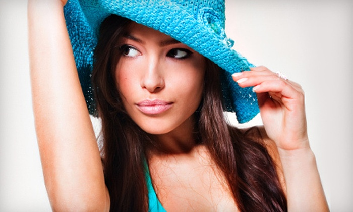 Ultimate Exposure Tanning Centers - Multiple Locations: $15 for Five Gold-Level UV Tans or Two Spray Tans at Ultimate Exposure Tanning Centers (Up to $70 Value)