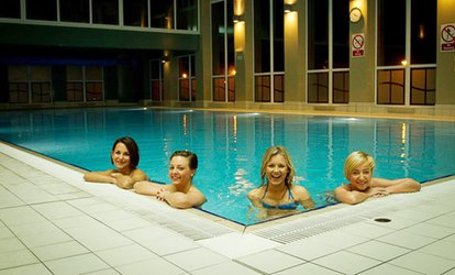 image for Spa Pass with Two Treatments, Drink and Pastry for One or Two at Forest Pines Hotel & Golf Resort