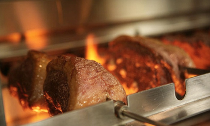 Em Chamas Brazilian Grill - Multiple Locations: $25 for $50 Worth of Brazilian Grill Fare at Em Chamas Brazilian Grill