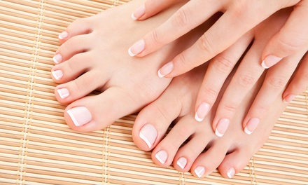 One or Two Basic or Shellac Mani-Pedis at Nails By Honey (Up to 51% Off)