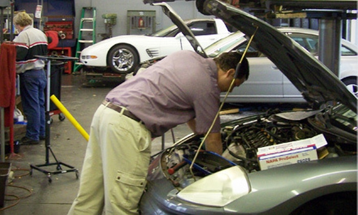 Tire Town Automotive Repair - East Leon: Oil Change with Tire Rotation and Inspections, or an Hour of Engine Diagnostics or Auto-Repair Labor at Tire Town Automotive Repair (Up to 75% Off)
