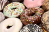 25% Cash Back at Somethin' Sweet Donuts