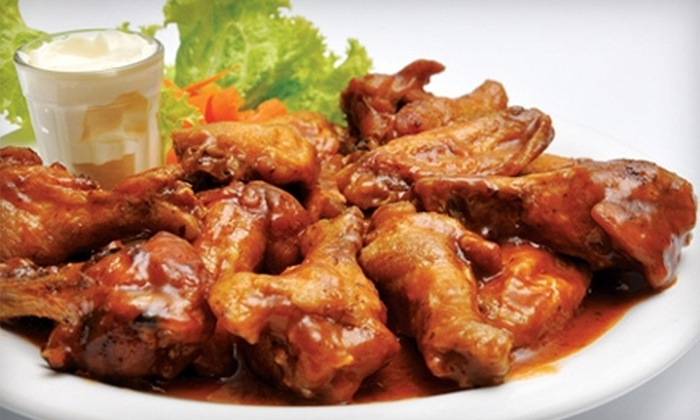 Red Zone Sports Bar & Grill - Doral: $7 for $15 Worth of Pub Fare and Drinks at Red Zone Sports Bar & Grill in Doral