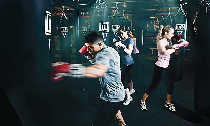 TITLE Boxing Club - Loveland - Multiple Locations: $15 for Two Weeks of Boxing and Kickboxing Classes with Take-Home Hand Wraps at Title Boxing Club ($57 Value)