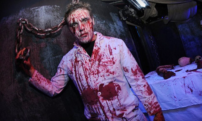 The Massacre Haunted House - Odyssey West: The Massacre Haunted House Visit for One or Four in Naperville (51% Off)