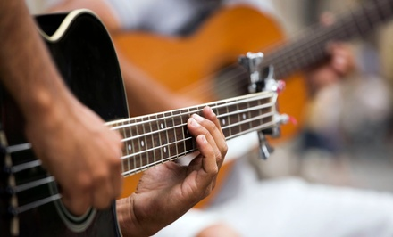 Four or Eight 30 or 60Minute Private Music Lessons, or Guitar Restringing at Sound City Music (Up to 56% Off)