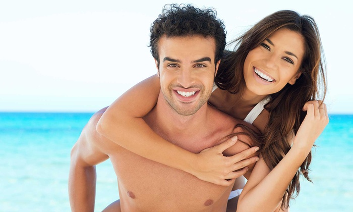 Tanning Hut - Woodbridge Township: Tanning Bed Access or Airbrush Tanning at Tanning Hut (Up to 62% Off). Six Options Available.