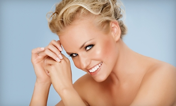 Lords & Ladies Salon - Harrisburg: $25 for Two Fantasy Airbrush Tans ($50 Value) or $22 for a Mani-Pedi ($45 Value) at Lords & Ladies Salon