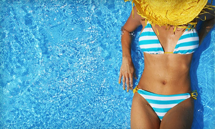 Gold Tans - Southport: One or Three Pura Spray Tans or One Month of Unlimited UV Tanning at Gold Tans (Up to 57% Off)