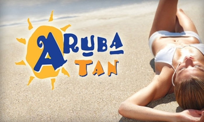 Aruba Tan - Desierto Plaza: $18 for One Airbrush Tan or Up to Five Tanning-Bed Sessions at Aruba Tan (Up to $38.88 Value)