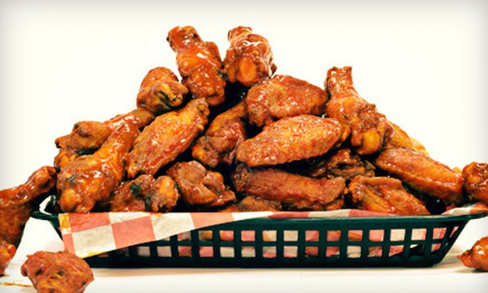 Conga's Bar & Lounge - Bayside: $29 for 30 Wings, Blackened Fries, and Beer or Sangria for Up to Six at Conga's Bar & Lounge in Bayside ($67 Value)
