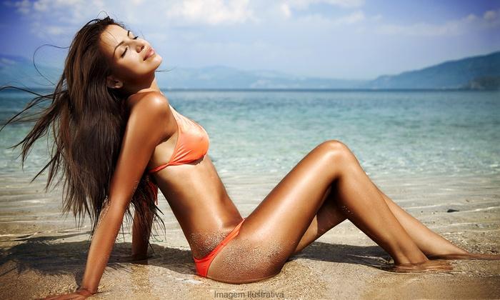House Of Hair - North Miami Beach: One Mystic Spray Tan at House of Hair Salon (43% Off)