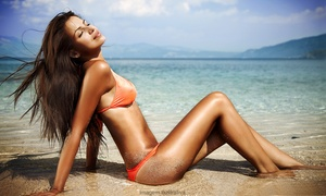 Tiki Tan - Granger : One or Three Spray Tans at Tiki Tan - Granger at Centennial Place (Up to 63% Off)