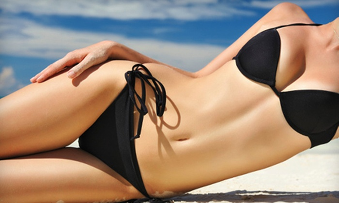 Ohana Tanning Salon - Raleigh / Durham: One Month of Unlimited UV Tanning or a Custom Airbrush Tan at Ohana Tanning Salon in Rolesville (Up to 51% Off)