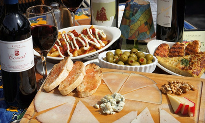 Little Spain - Mid-Wilshire: $40 for Four Shareable Tapas Plates and a Bottle of Wine for Two to Six People at Little Spain (Up to $83 Value)