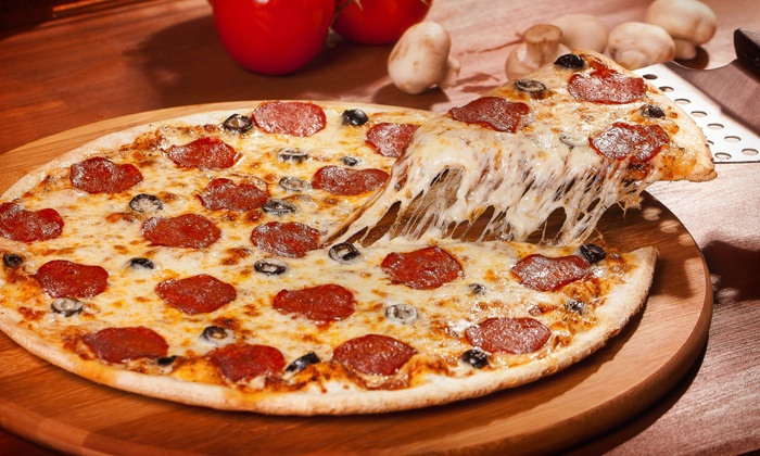 Rocky's Pizzeria & Ice Cream - North Chicago - Lake View Estates: Pizza, Sandwiches, and Ice-Cream at Rocky's Pizzeria (Up to 50% Off). Three Options Available.