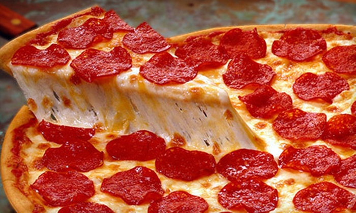 Auburn Pizza Lounge - Downtown: Pizza, Wings, and Drinks at Auburn Pizza Lounge (Up to 56% Off). Two Options Available.