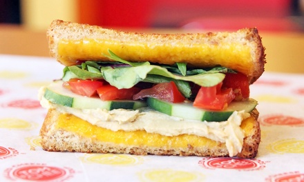 $14 for Two Groupons, Each Good for $12 Worth of Grilled Cheese, Soup, and Salad at Tom+Chee ($24 Value)