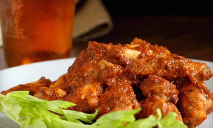 Quincy Magoo's - Southeast Springfield: 40 Wings or 16-Inch Pizza with a Pitcher of Domestic Beer, or $12 for $24 Worth of Pub Fare at Quincy Magoo's