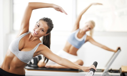 6 or 12 Pilates Reformer or Reformer-TRX Combo Classes with Orientation at Passport Pilates (Up to 60% Off)