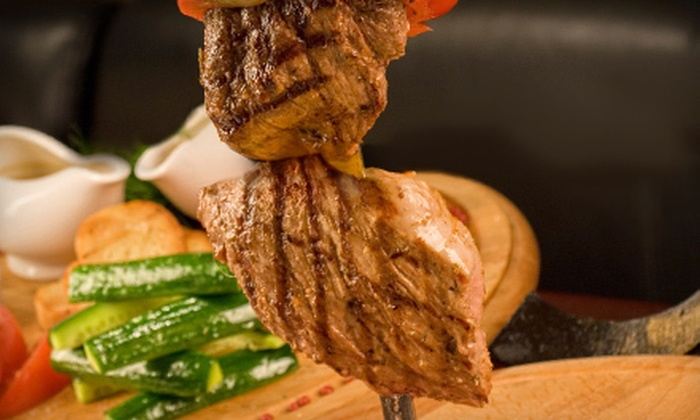 Brazilian Cowboy Steakhouse & Grill - Plano: Grilled Meats and Appetizers at Brazilian Cowboy Steakhouse & Grill (Half Off). Two Options Available.